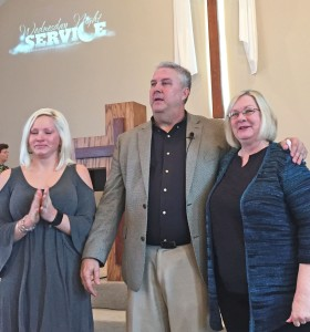 Lynn Conerly (Right) Standing with Lynn is her daughter Corry and Pastor Doug